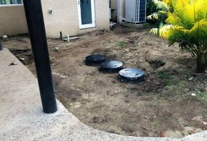 The individual sewage treatment plants for the villas are designed to disappear into the tropical gardens.