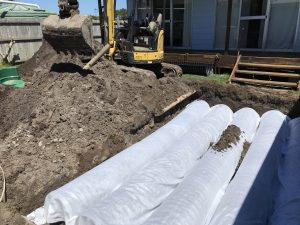 The Land Application Area design included trenches that needed to be installed in limited space between the house and an existing shed.