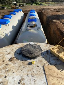 The tanks and STP modules are carefully installed below ground.