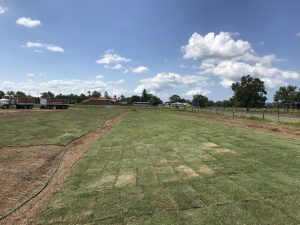 Wisconsin mounds nearing completion, final turfing taking place.