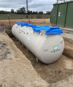 Prefabricated Kubota wastewater treatment system being installed adjacent to existing infrastructure to enable a smooth transition from old to new.